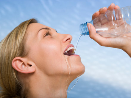 Woman drinking healthy water