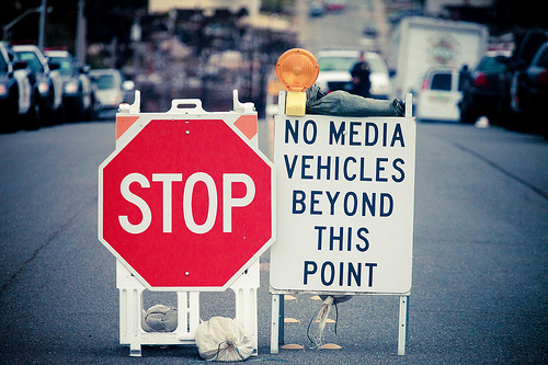 Stop sign and no media sign